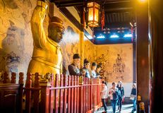 At the 600-year-old Old City God Temple, Shanghai, China. Shanghai, China - Nov 6, 2016: Inside the 600-year-old Old City God Temple. Visitors enter the main stock images