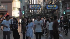 Shanghai, China - October 31, 2018: Busy crowded shopping street, people walk through the pedestrian only Nanjing Road stock footage