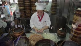 Shanghai, China - Sep 11, 2013: video of Chefs making Shanghai dumplings, also called xiaolongbao stock video