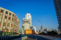 SHANGHAI, CHINA: Some tall modern buildings making up the horizon, walking on the streets of Shanghai.  royalty free stock photo
