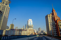 SHANGHAI, CHINA: Some tall modern buildings making up the horizon, walking on the streets of Shanghai.  royalty free stock photography