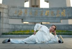 A man exercises and does Tai Chi on the Bund as the sun rises stock photography