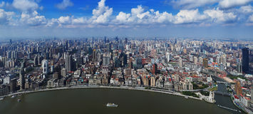 Shanghai city. Aerial view of Shanghai city and coastline with blue sky and cloudscape background Royalty Free Stock Photography