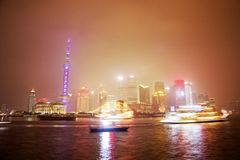 Shanghai city skyline illuminated at night Stock Photos