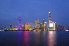 Shanghai city skyline Pudong side looking through Huangpu river on twilight time. Royalty Free Stock Photo