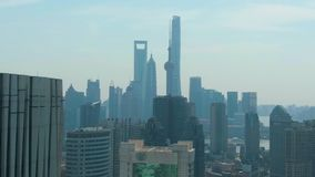 Shanghai City. Urban Lujiazui Skyline at Sunny Day. China. Aerial View. Drone Flies Backwards stock footage