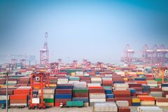 Shanghai container port in morning fog. Modern seaport view stock image