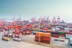 Shanghai container port in nightfall Stock Photos