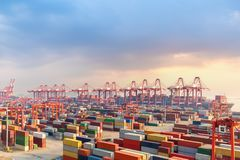 Shanghai container terminal at dusk. One of the largest cargo port in the world Stock Photo