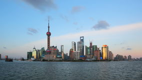 Shanghai from day to night, zooming timelapse. Pudong cityscape viewed from the Bund, Shanghai, China