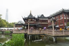 SHANGHAI - DEC 28 2017:  tourists visit in Pavilions, teahouses. And street market in Yuyuan garden with rain, Shanghai, China. Yuyuan Market is a 15th century Royalty Free Stock Image