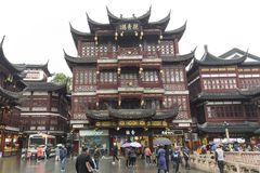SHANGHAI - DEC 28 2017:  tourists visit in Pavilions, teahouses. And street market in Yuyuan garden with rain, Shanghai, China. Yuyuan Market is a 15th century Royalty Free Stock Photography