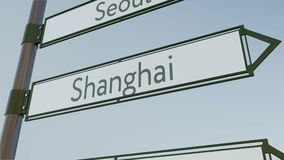 Shanghai direction sign on road signpost with Asian cities captions. Conceptual 3D rendering Royalty Free Stock Photo