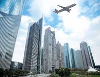 Shanghai financial district and airplane Stock Photos