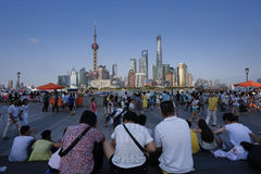 SHANGHAI-JULY 20, 2014. Tourists on Bund looking at the Lujiazui Royalty Free Stock Images