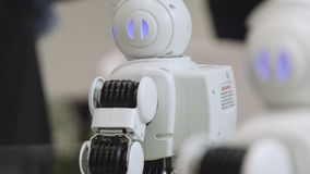 SHANGHAI - JUNE 28 2018: A small robot with human face and body - humanoid. Closeup of an cute autonomous service robot. Close-up of robot head royalty free stock photography