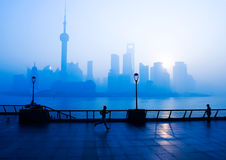 Shanghai life. SHANGHAI - November 20:  People running on the Bund , Oriental Pearl Tower in the distance, on November 21 morning, 2010 in Shanghai, China.  One Stock Photography