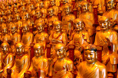 Shanghai - Longhua Temple. China, Shanghai city. Longhua Temple. Hundreds of golden buddhas sculptures having gathering inside temple Stock Image