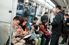 Shanghai metro. Shanghai, China - March 20th, 2013: Chinese people with mobile phones in Shanghai metro train Royalty Free Stock Photo