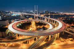 Shanghai nanpu bridge at night. Beautiful approach bridge of shanghai nanpu at night ,spiral in a complex curve Royalty Free Stock Image