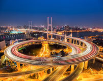 Shanghai nanpu bridge at night. Beautiful spiral approach bridge ,China Royalty Free Stock Photos
