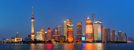 Shanghai at night. Urban skyscrapers in Shanghai at night over river Royalty Free Stock Image