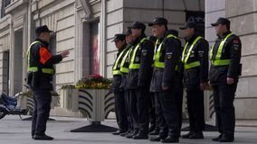 SHANGHAI - OCTOBER 30, 2019: Chinese Police Squad is Listening to the Instructions from their Leader Outside, Daytime