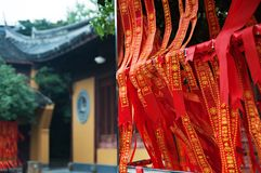 Shanghai old buddhist temple, Longhua Temple, traditional red ribbons with wishes.  Royalty Free Stock Photos