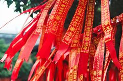 Shanghai old buddhist temple, Longhua Temple, traditional red ribbons with wishes.  Stock Photography