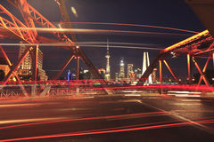 Shanghai old garden bridge car light trails Stock Photo