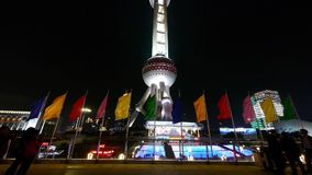 Shanghai Oriental Pearl Tower & flying flg at night,timelapse moving people. stock footage