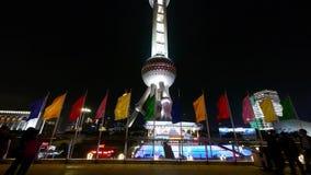 Shanghai Oriental Pearl Tower & flying flg at night,timelapse moving people. Shanghai Oriental Pearl Tower with flying flg at night,timelapse moving people stock footage