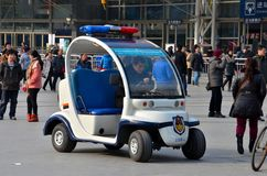 Shanghai Police golf cart buggy vehicle outside railway station, China Stock Photography
