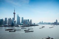 Shanghai pudong and the huangpu river. Shanghai pudong skyline and busy huangpu river Stock Photo