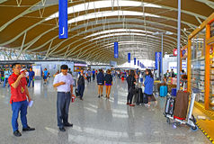 Shanghai pudong international airport departure hall, china. Interior view of crowded shanghai pudong international airport departure hall, shanghai, china stock image
