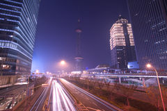 Shanghai Pudong night highway. Shanghai Pudong financial center in the night city road trace Stock Photos