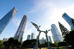 Shanghai Sculptures with tall building Stock Photos