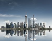 Shanghai skyline against a sunny sky and reflection. Abstract metropolis cityscape royalty free stock photo