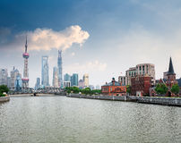 Shanghai skyline and beautiful suzhou river. Beautiful suzhou river with shanghai skyline against a blue sky Royalty Free Stock Images