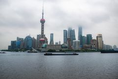 Shanghai skyline on a cloudy day with the skyscrapers covered in clouds and mist stock photo