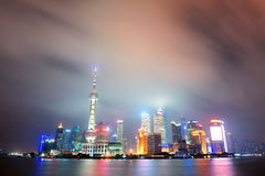 Shanghai skyline at night Stock Images