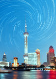 Shanghai skyline night, China. Shanghai city tower and cityscape at night with star trails in rotation style Stock Photo