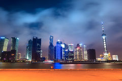 Shanghai skyline with pier at night Stock Photography
