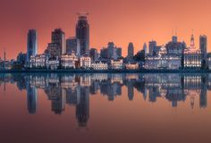 Shanghai skyline during the red sunset, China. Scenery view of Shanghai skyline and Huangpu river with reflection on water, China. Clipping path of sky royalty free stock photos