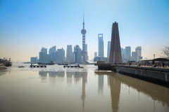 Shanghai skyline reflection in river. Shanghai skyline reflection in the suzhou river ,water surface calm as a mirror ,China Stock Photography