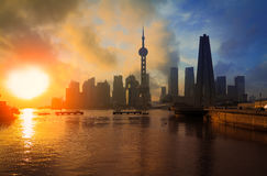 Shanghai Skyline rising sun viewed from the Bund Stock Photography