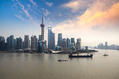 Shanghai skyline with sunset glow Stock Images