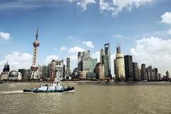 Shanghai skyline and a tugboat Stock Photos