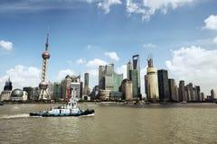 Shanghai skyline and a tugboat Stock Photos