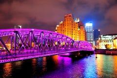 Shanghai Waibaidu bridge. At night with colorful light over river Stock Photos